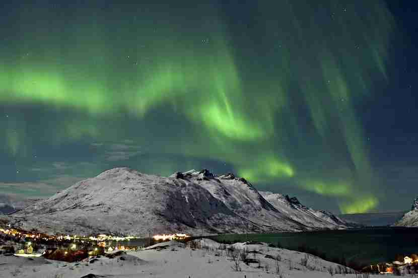 Make your way to the Arctic Wilderness for an almost guaranteed sighting of the Northern Lights over Ersfjord in Tromsø. Image courtesy of Bjørn Jørgensen/VisitNorway.com.