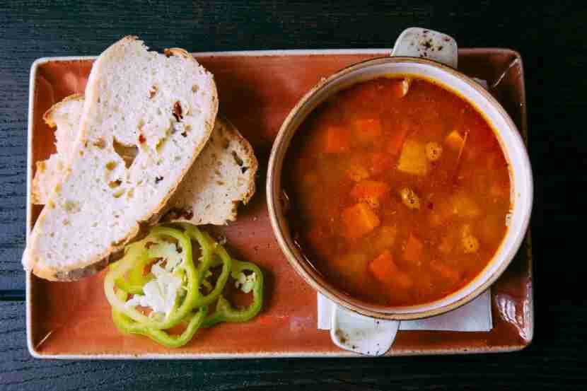 Paprika lends its vibrant red color to many Hungarian dishes, like goulash. Image courtesy of disqis via Getty Images.