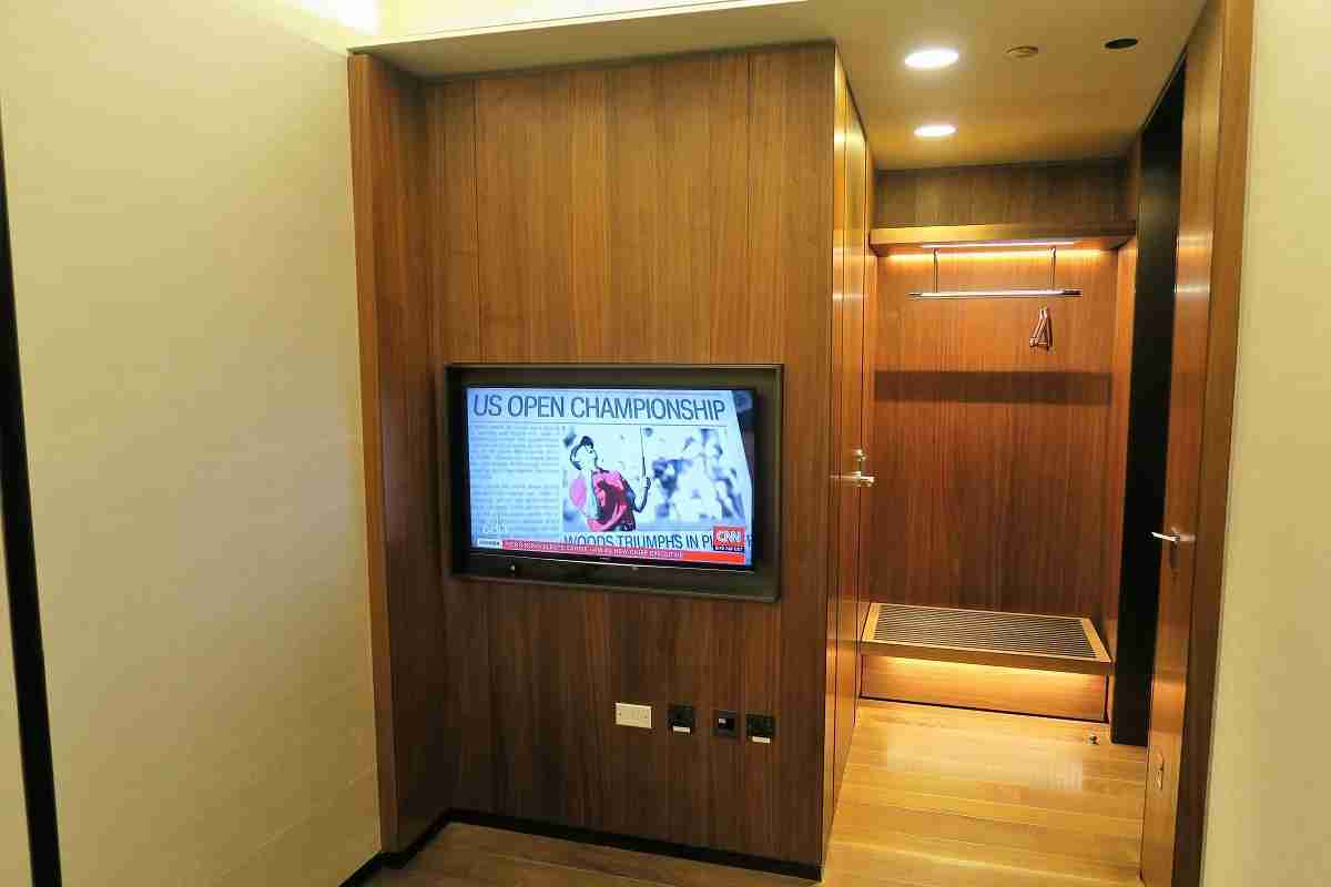Qatar First Class lounge private room TV and baggage