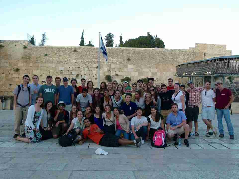 Then-college student Samantha Rosen takes a group photo in front of the Western Wall.