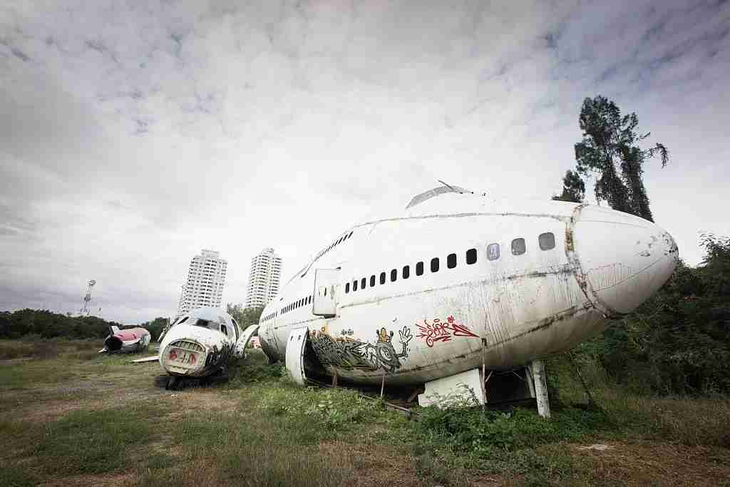 Visit some abandoned planes in Bangkok. Photo courtesy of Pacific Press via Getty.