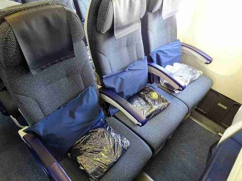 Pillows and blankets await you in Economy.