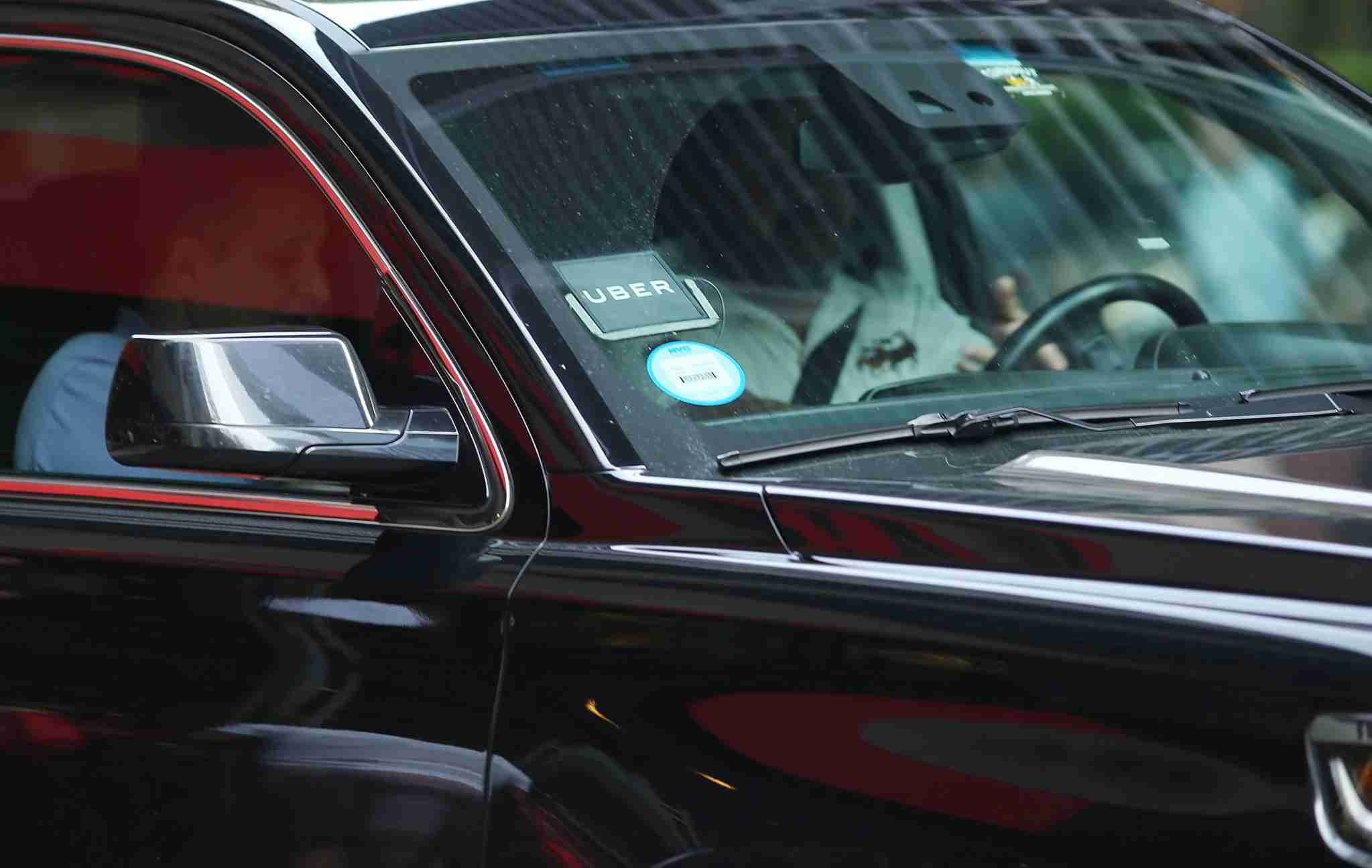 NEW YORK, NY - JUNE 14: An Uber car waits for a client in Manhattan a day after it was announced that Uber co-founder Travis Kalanick will take a leave of absence as chief executive on June 14, 2017 in New York City. The move came after former attorney general Eric H. Holder Jr. and his law firm, Covington & Burling, released 13 pages of recommendations compiled as part of an investigation of sexual harassment at the ride-hailing car service. (Photo by Spencer Platt/Getty Images)