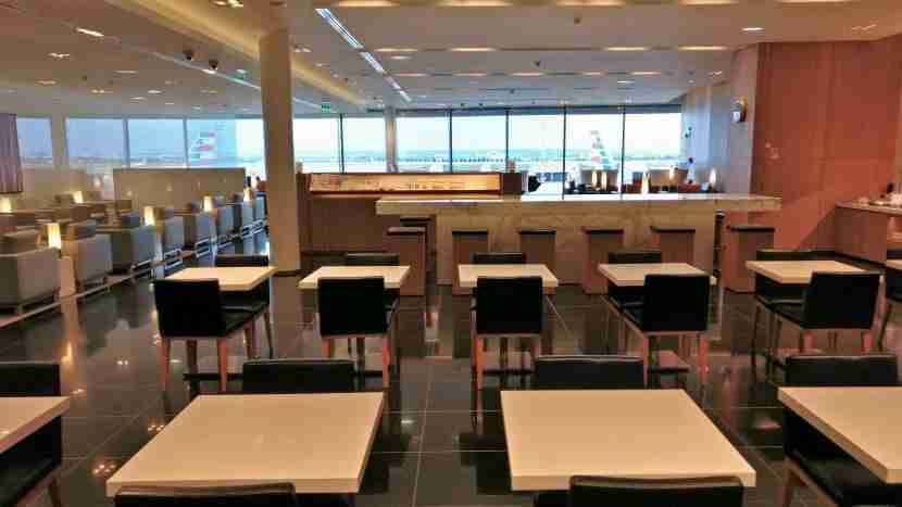 The view upon entering the lounge shows smart seating and a great view of the runway.