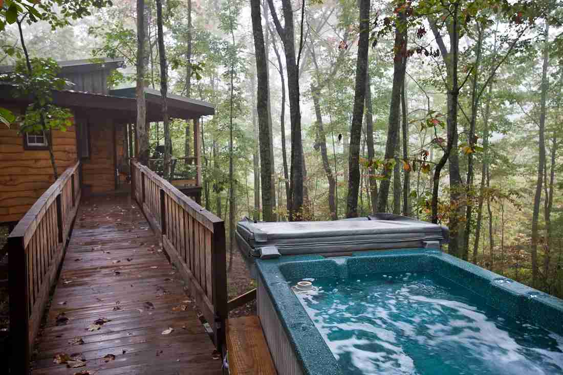 The deck holds a 4 person hot tub and swinging chair for relaxation. Photo courtesy of Sheila Tjelmeland.