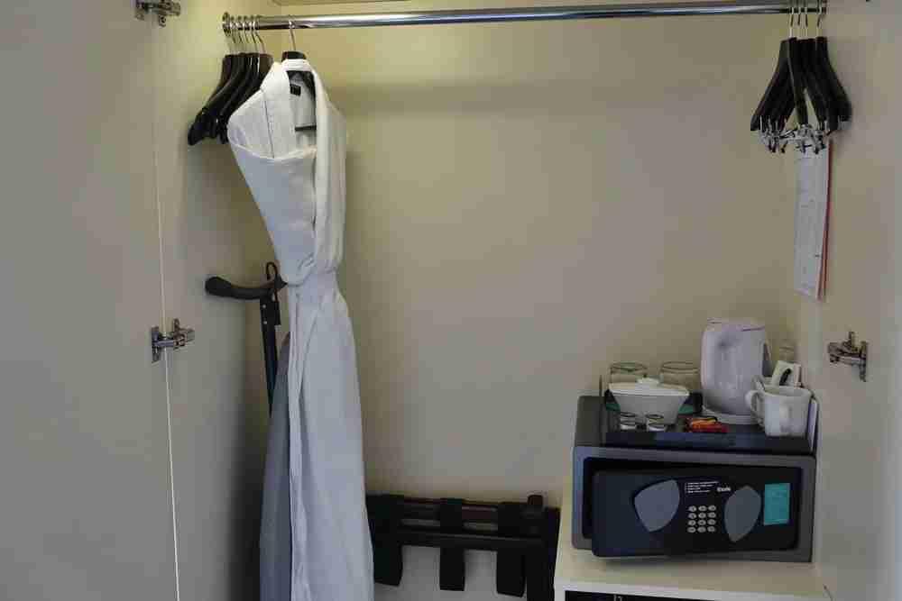 Robe, safe, coffee and tea inside the closet.
