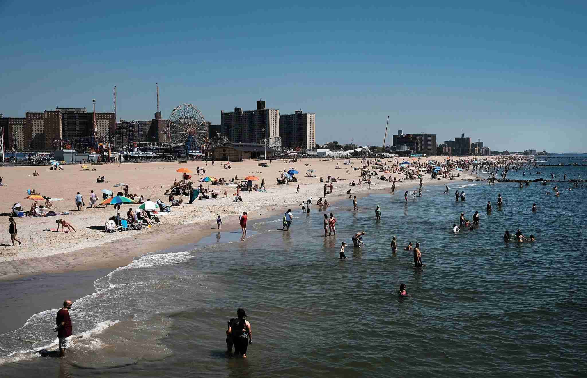 NEW YORK, NY - AUGUST 24: People swim in the ocean at Coney Island during a week of ideal summer weather in New York City on August 24, 2016 in New York City. Thousands of New Yorkers and tourists alive have been flocking to beaches, parks and public pools to take advantage of the last weeks of summer. (Photo by Spencer Platt/Getty Images)