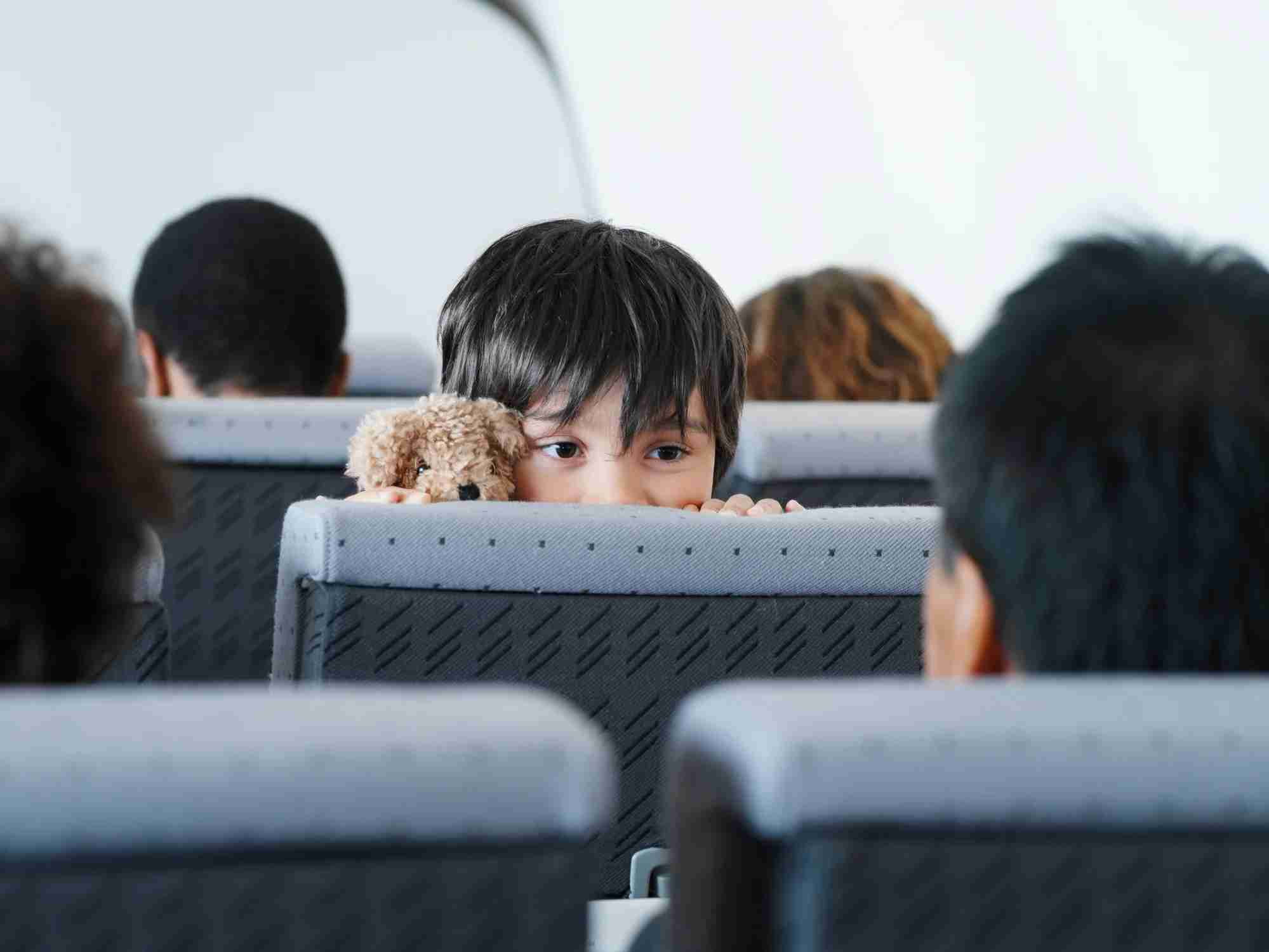 Keeping an eye on your little ones while sitting in coach makes travel easier for everyone. Image courtesy of ColorBlind Images via Getty Images.