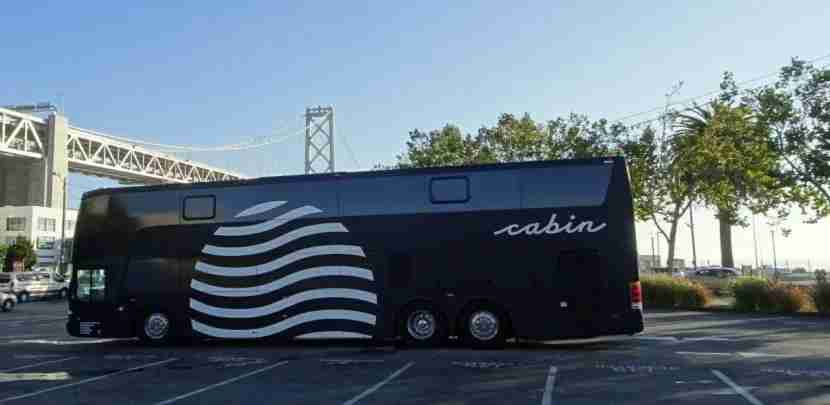 The Cabin bus lets passengers off in San Francisco at a parking lot near the Bay Bridge.