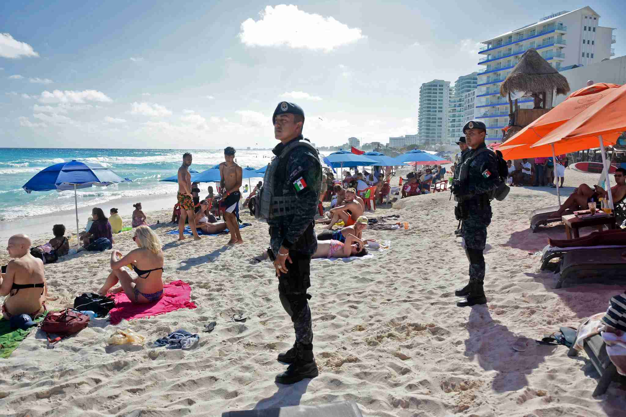 The Mexican federal police patrol a beach in Cancun, Mexico on January 18, 2017, where a shooting occurred in a nightclub the day before. The shooting happened on January 17, as Mexican authorities investigate whether a feud over local drug sales was behind a nightclub shooting that killed three foreigners and two Mexicans Monday at the Blue Parrot club during the BPM electronic music festival in Playa del Carmen, a usually peaceful Caribbean seaside town. / AFP / STR (Photo credit should read STR/AFP/Getty Images)