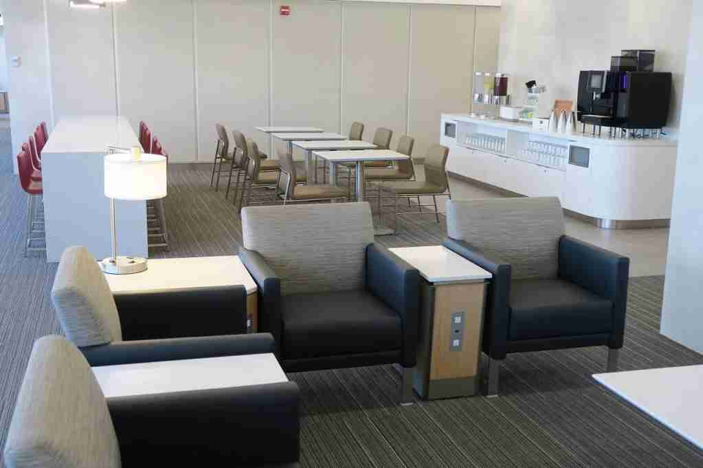 AA ORD Flagship Lounge - sitting area with coffee machine
