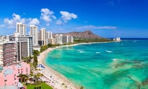 Honolulu hawaii resort waikiki beach in afternoon sun.