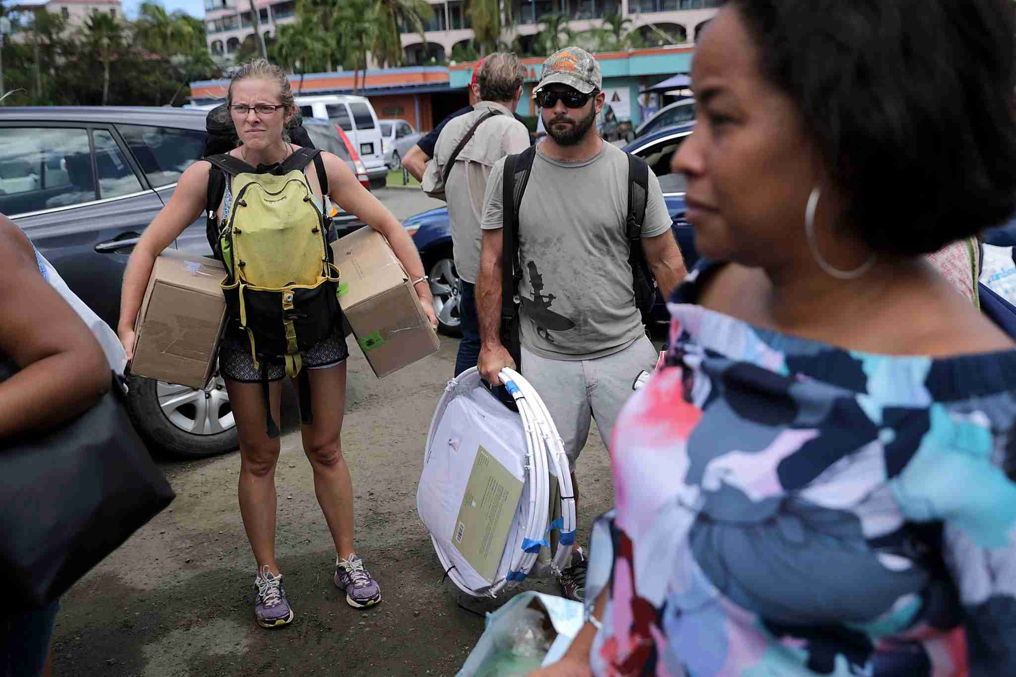 Passengers carry supplies onto a ferry taking them to St. Thomas on September 17, 2017 in Christiansted, St Croix, US Virgin Islands. (Photo by Chip Somodevilla/Getty Images)