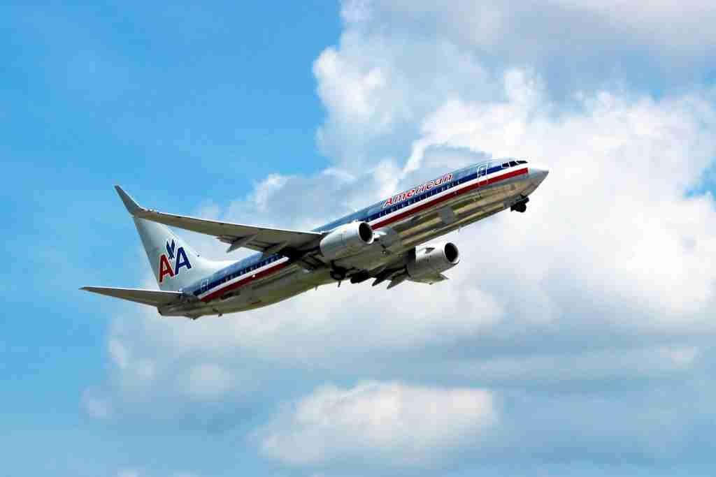 A silver bird 737 takes flight at MIA