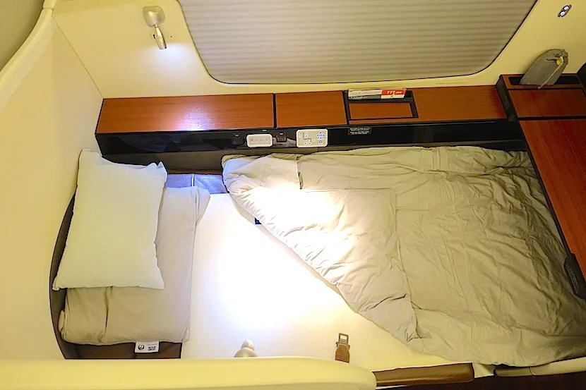 JAL first class bed overhead