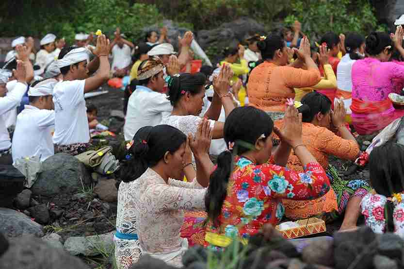 Balinese Hindus take part in a ceremony, where they pray near Mount Agung in hope of preventing a volcanic eruption, in Muntig village of the Kubu sub-district in Karangasem Regency. Photo by SONNY TUMBELAKA/AFP/Getty Images