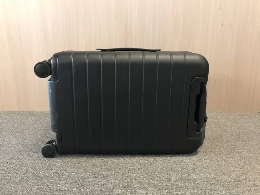 You can clearly see scuffs on the underside of the suitcase.
