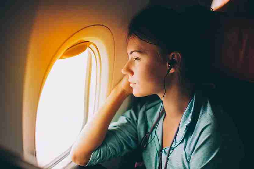 woman,plane,crying,window seat,pensive