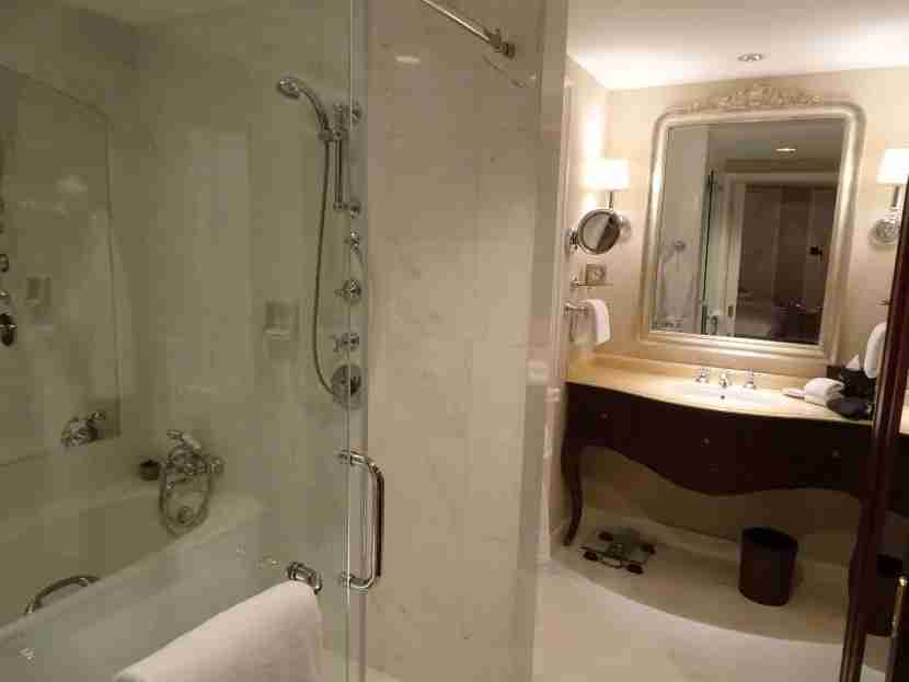 This bathroom felt luxurious, with all the marble and a side-by-side tub and shower.