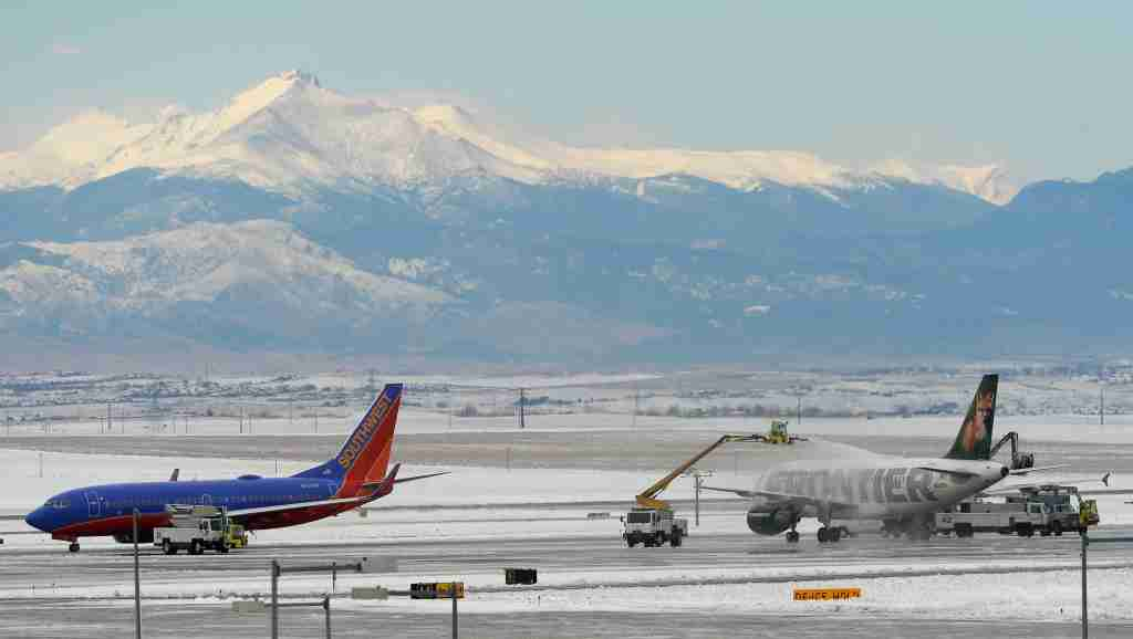 DENVER, CO - NOVEMBER 17: Snow hit the Denver metro area having an impact on air travel at Denver International Airport. They were de-icing planes with a splendid view of Longs Peak in the distance on Tuesday, November 17, 2015. (Photo by Cyrus McCrimmon/The Denver Post via Getty Images)