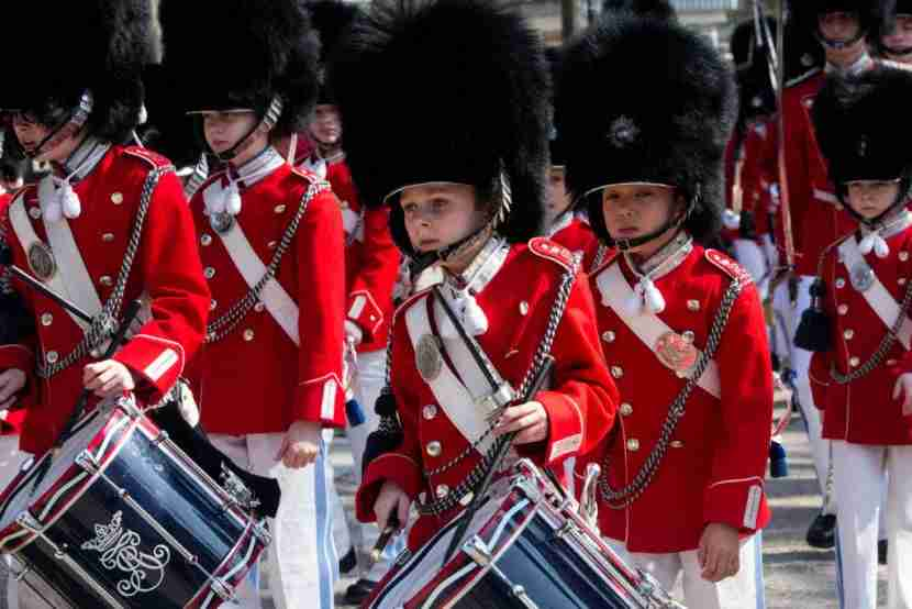 COPENHAGEN, DENMARK - APRIL 09: The Tivoli Guard are seen marching through the Tivoli Garden during the first Sunday of the new season on April 9, 2017 in Copenhagen, Denmark. The Tivoli Guard, once male only, have 90 members for children 8 to 16 years of age and now include 9 girls. The guard itself goes back to the year after the amusement park was established in 1843 in the very center of Copenhagen. (Photo by Ole Jensen - Corbis/Corbis via Getty Images)