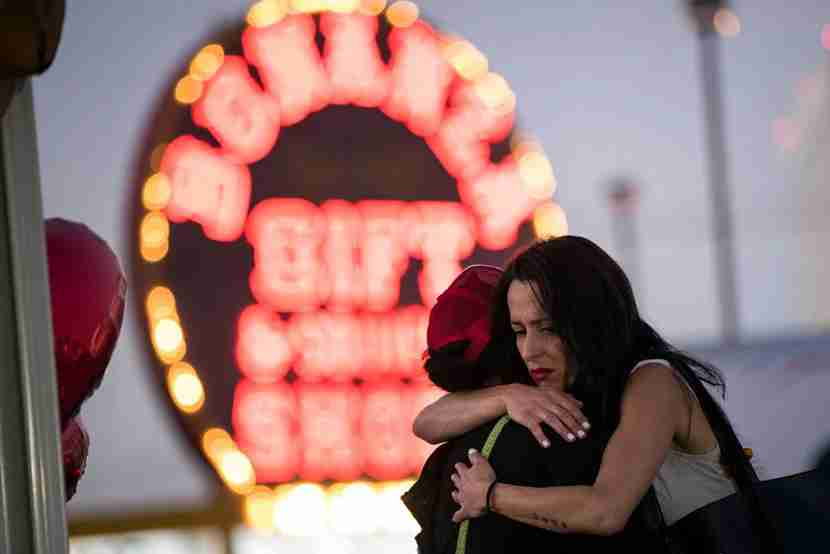 LAS VEGAS, NV - OCTOBER 4: Las Vegas resident Elisabeth Apcar (R) hugs a woman who was working at the concert venue on Sunday night (she wished to remain anonymous), at a makeshift memorial at the northern end of the Las Vegas Strip, October 4, 2017 in Las Vegas, Nevada. On October 1, Stephen Paddock killed at least 58 people and injured more than 450 after he opened fire on a large crowd at the Route 91 Harvest country music festival. The massacre is one of the deadliest mass shooting events in U.S. history. (Photo by Drew Angerer/Getty Images)