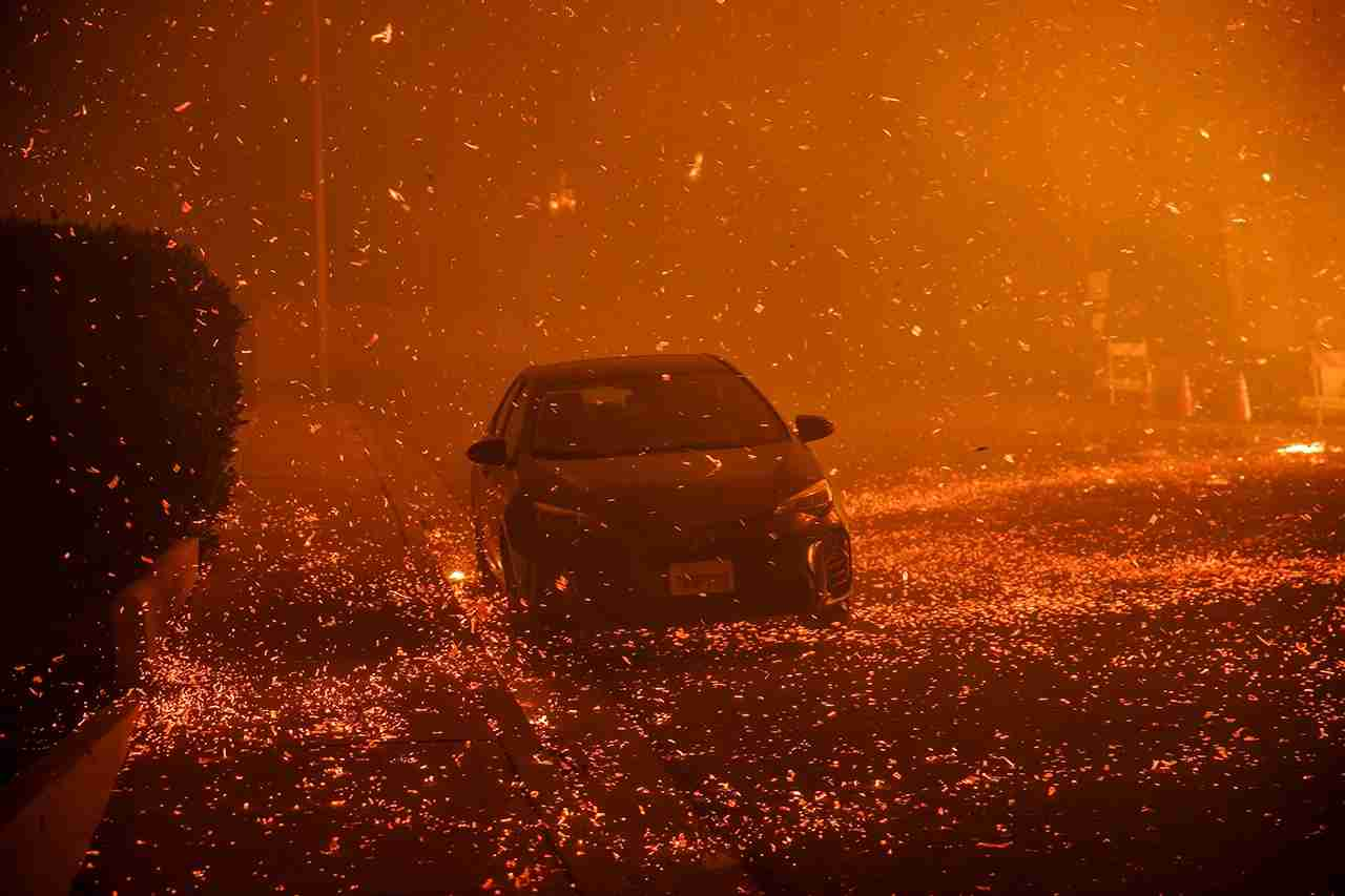 A brushfire moving with the wind sends embers all over the place in residential neighborhoods north of Ventura, California. (Photo by Marcus Yam / Los Angeles Times via Getty Images)