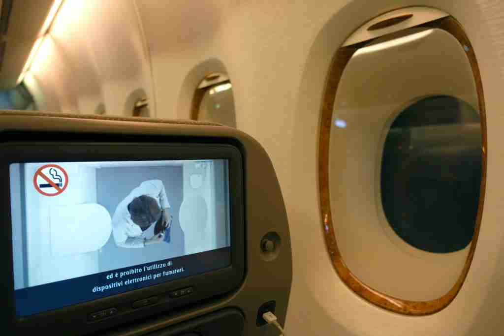 Window and IFE screen in economy class on the Emirates A380 between New York (JFK) and Milan, Italy (MXP).