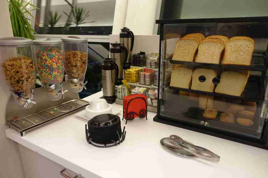 Cereal and bread at the Wingtip Lounge at New York JFK, a Priority Pass lounge.