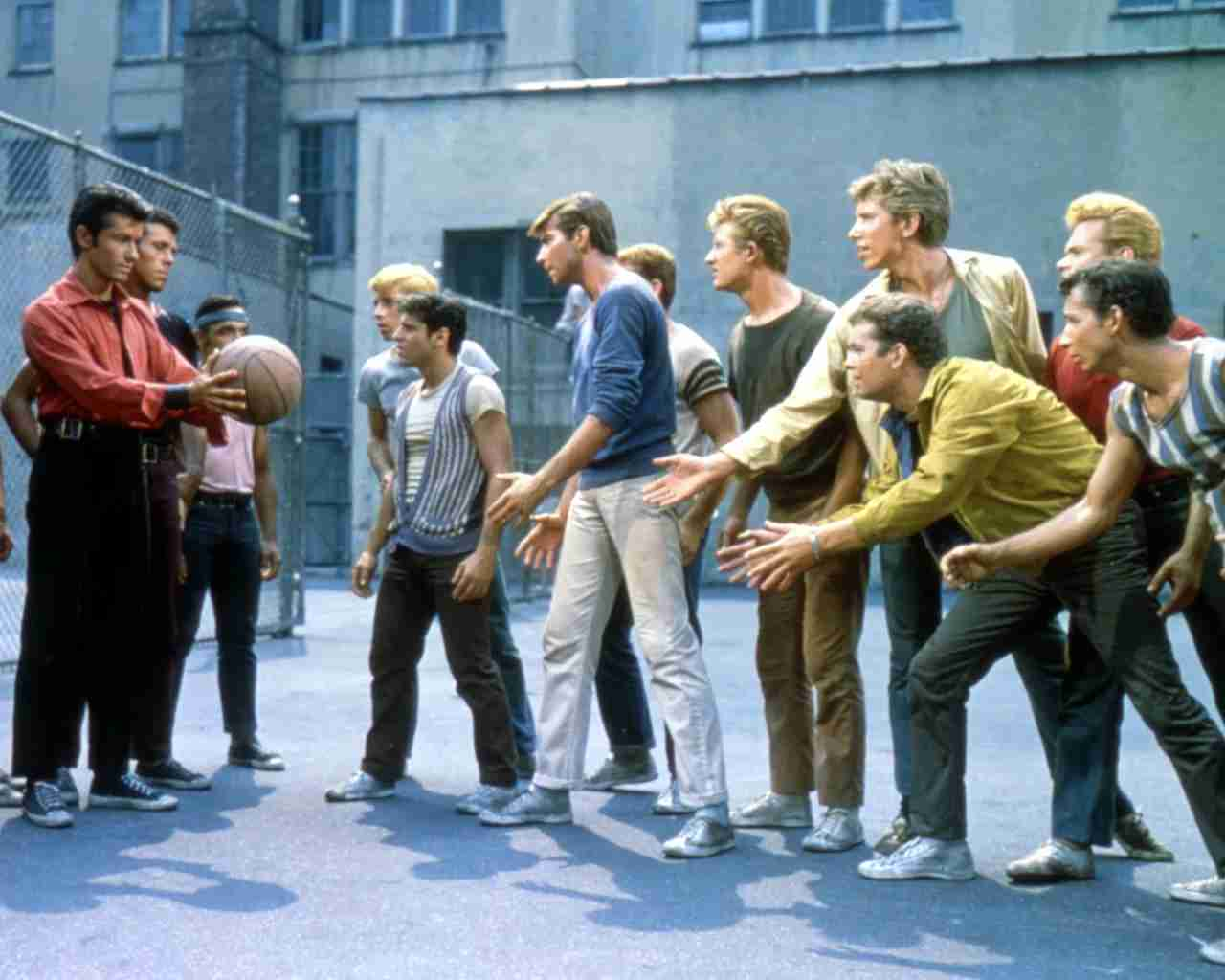 Actors George Chakiris, Tony Mordente, Tucker Smith and Russ Tamblyn in a scene from the musical film