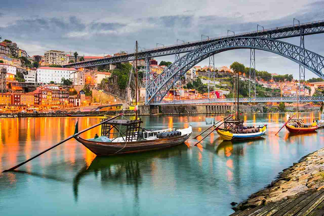 Porto, Portugal old town skyline on the Douro River with rabelo boats. (Photo by Getty Images)