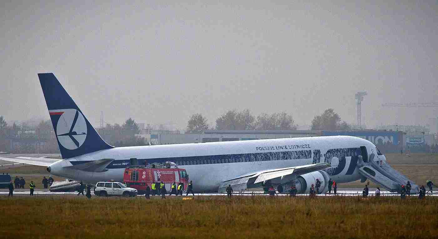 Fire engines and emergency vehicles surround a LOT Polish airlines Boeing 767 after it made an emergency landing at Warsaw
