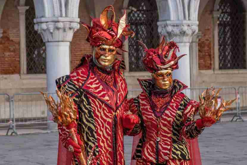 VENICE, ITALY - FEBRUARY 04: People wearing carnival costumes pose during the Flight of Angel on February 4, 2018 in Venice, Italy. The theme for the 2018 edition of Venice Carnival is