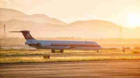 Meridiana MD80 arriving at Cagliari Elmas Airport