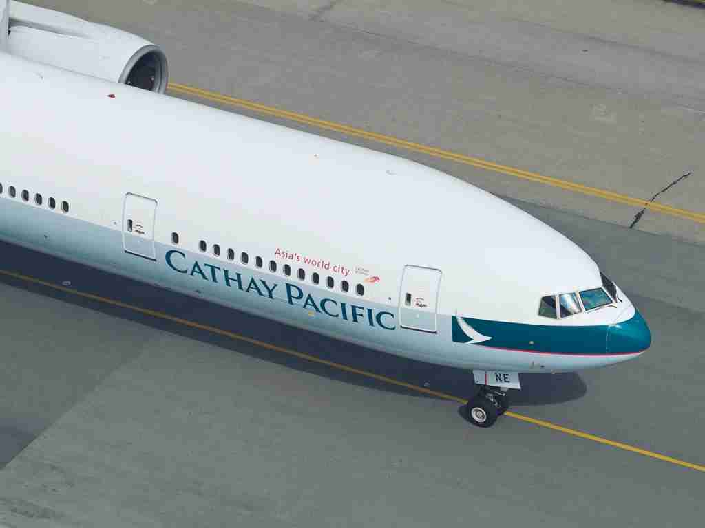 Hong Kong, Hong Kong SAR - December 30, 2012: Cathay 777Cathay Pacific Boeing 777-300 taxing in Hong Kong. Cathay pacific is a Hong Kong based airline. It currently operates 136 aircraft and has firm orders for another 96. (Photo by Frogman1484/Getty Images)