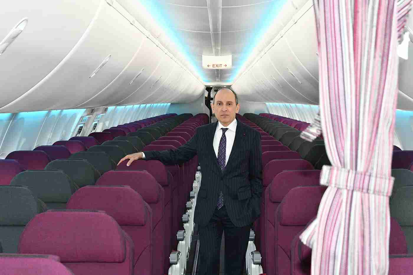 Akbar al Baker in the cabin, with the curtain that will separate the business and coach sections