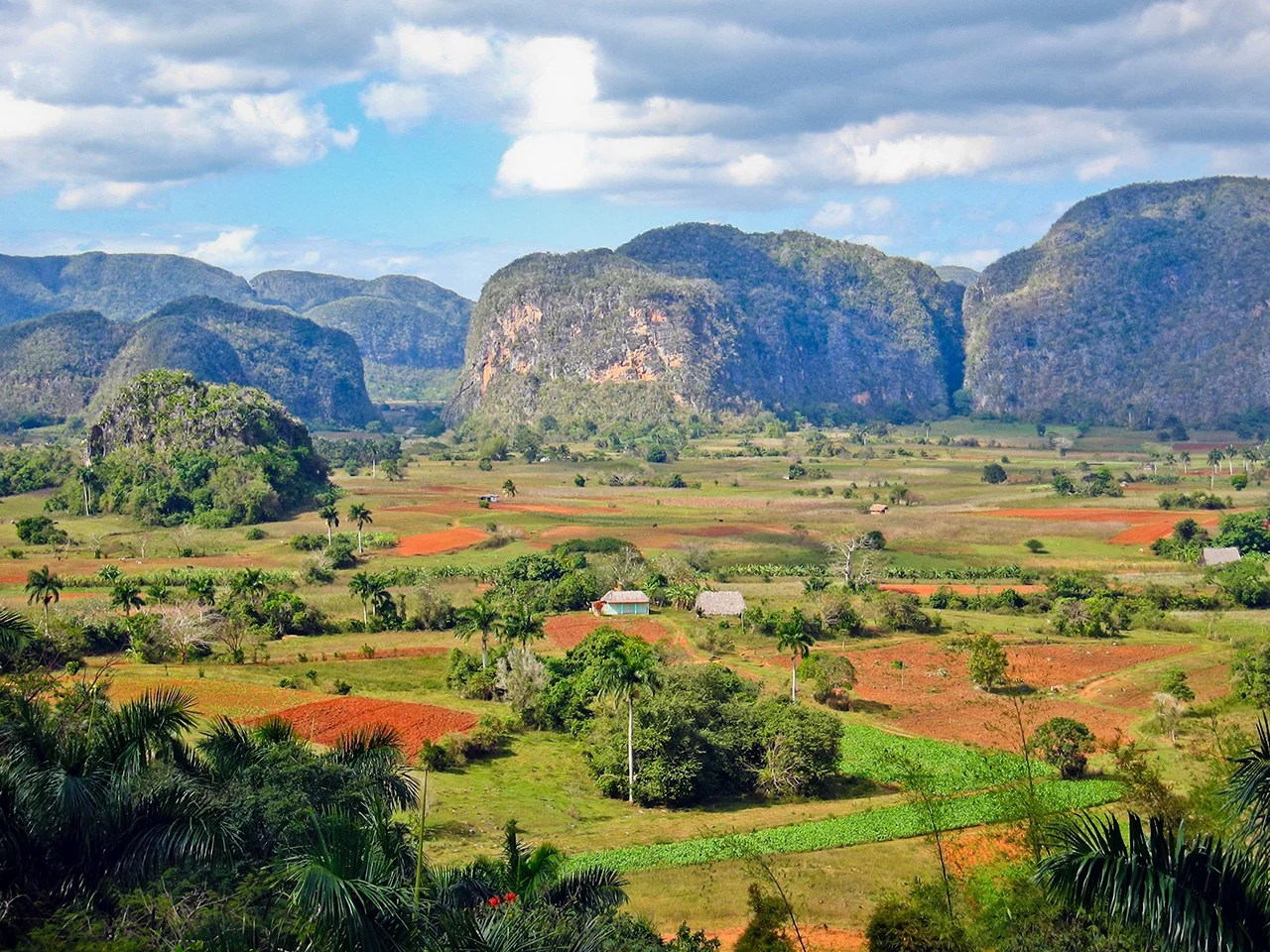 The mogotes are peculiar limestone hills with rounded top that emerge from the wide Valle de Viñales, famous for the tobacco growing. The valley was declared a UNESCO World Heritage Site in 1999. (Photo by oriredmouse/Getty Images)