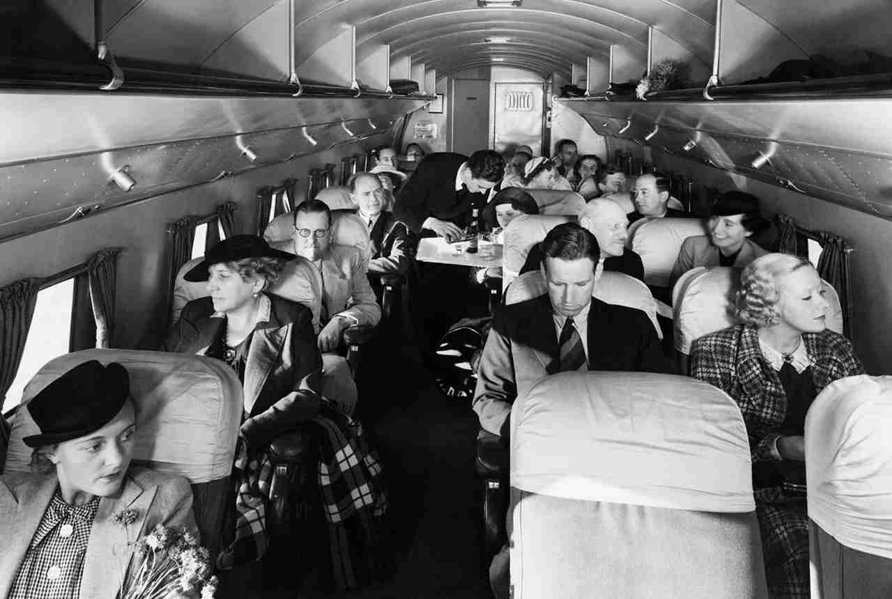 Steward Serving Passengers Aboard Douglas DC-3 Aircraft (Photo by Hulton-Deutsch/Hulton-Deutsch Collection/Corbis via Getty Images)
