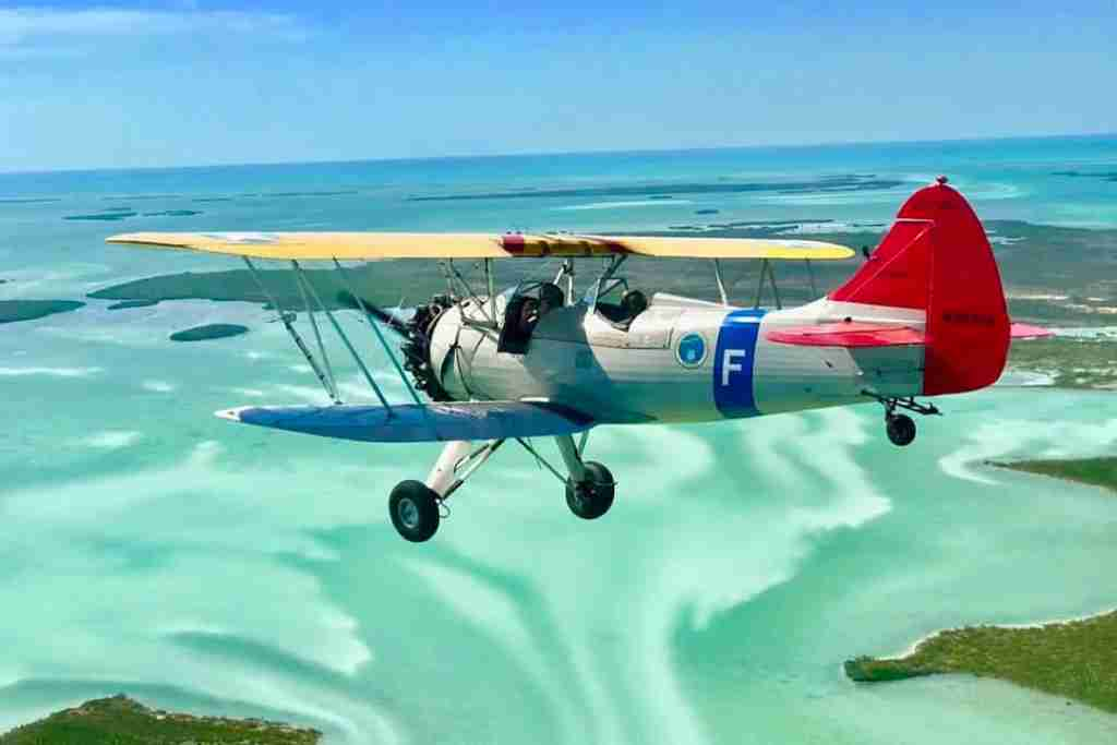 Flying a Waco biplane in the Florida Keys. Image via @katiemarsh