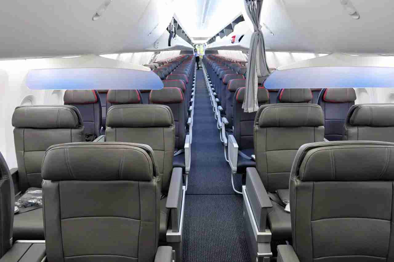 An American Airlines 737 Max 8 plane interior. Single aisle aircraft are not required by the ADA to have a wheelchair accessible bathroom.