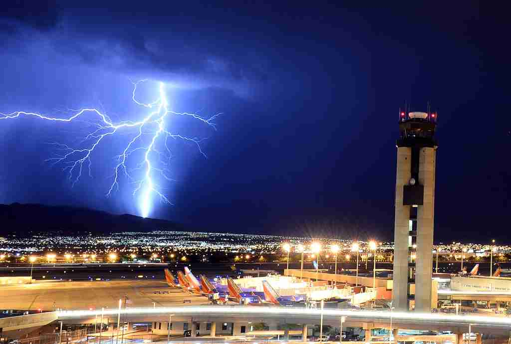 LAS VEGAS, NV - AUGUST 18: Lightning flashes behind an air traffic control tower at McCarran International Airport on August 18, 2013 in Las Vegas, Nevada. Thunderstorms swept across the area on Sunday prompting the National Weather Service to issue multiple severe thunderstorm and flash flood warnings. (Photo by Ethan Miller/Getty Images)