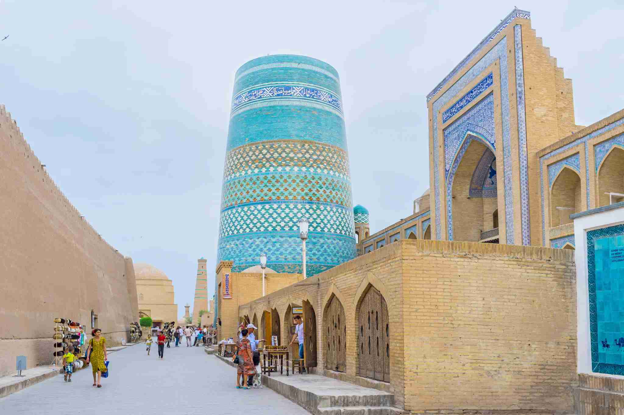 Khiva, Uzbekistan - May 3, 2015: The central street with the Kalta Minor Minaret, Muhammad Amin-Khan Madrasah and the tiled map of the town-fortress.