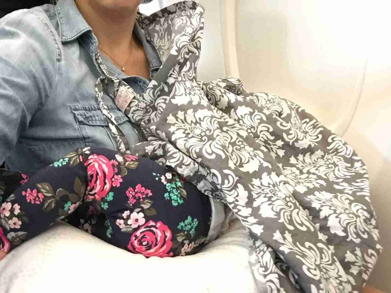 Baby nursing on a plane