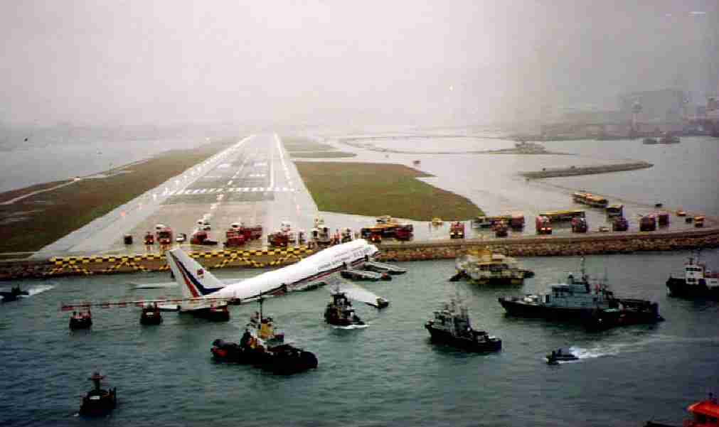 HONG KONG, HONG KONG: China Airlines 747 sits in the water after skidding off the runway at Kai Tak airport in Hong Kong 04 November 1993. Foul weather and a slippery runway caused by Tropical Storm Ira forced the passenger jet to skid and plunge into the sea. There were no fatalities. (Photo credit should read GIS/AFP/Getty Images)