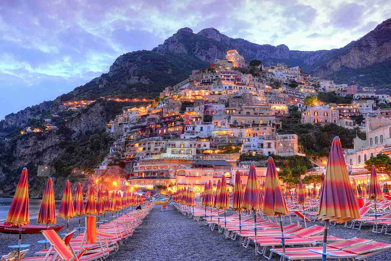 Positano at sunset. (Photo by Cristinatrif/Getty Images)