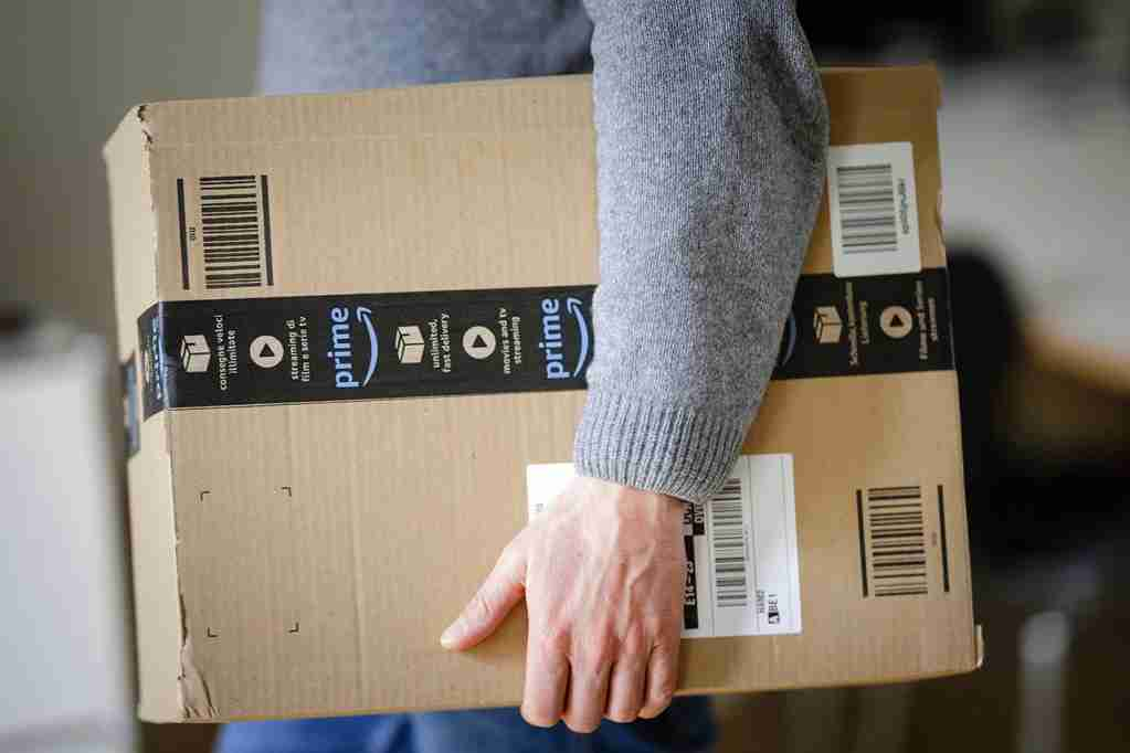 A man is holding an Amazon Prime package on March 20, 2018 in Berlin, Germany. (Photo by Thomas Trutschel/Photothek via Getty Images)