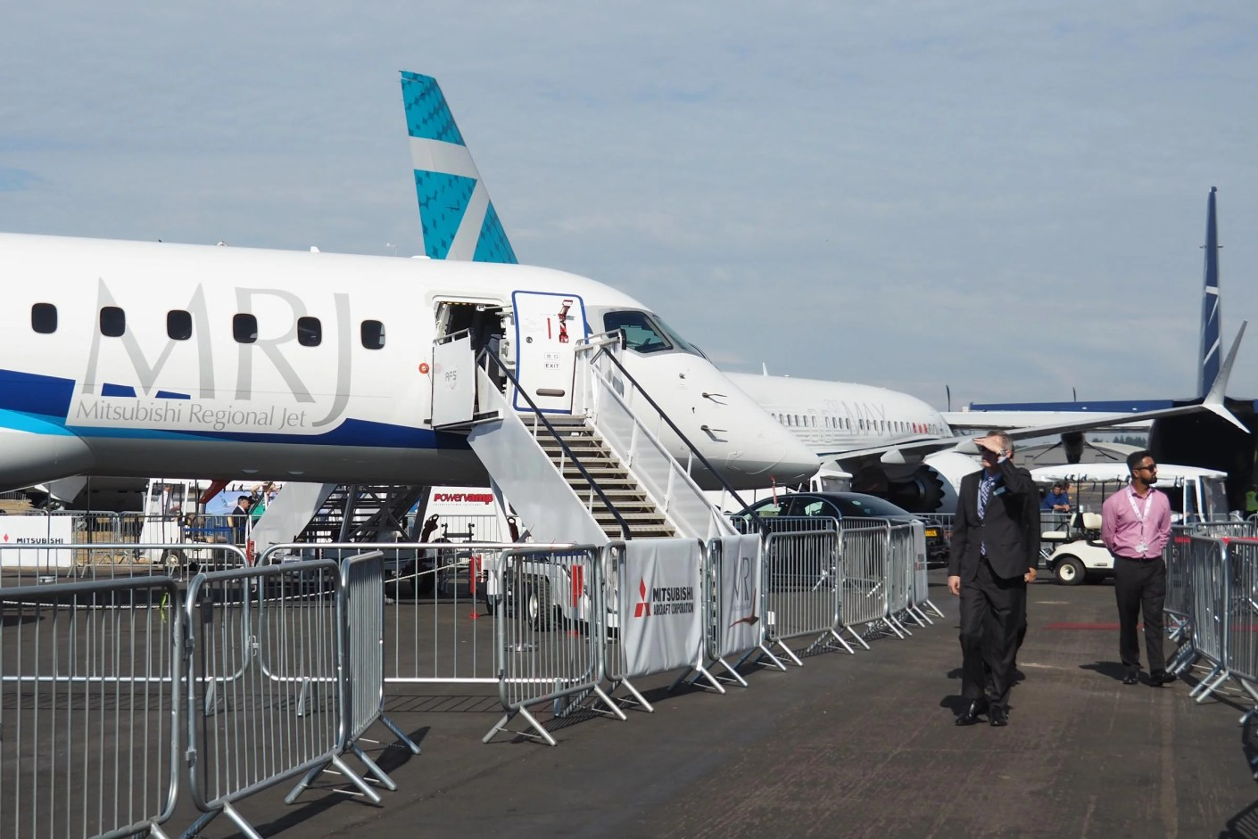 A Mitsubishi MRJ regional jet parked close to a Boeing 737 MAX 7 at the Farnborough Air Show (Photo by Zach Honig / The Points Guy)
