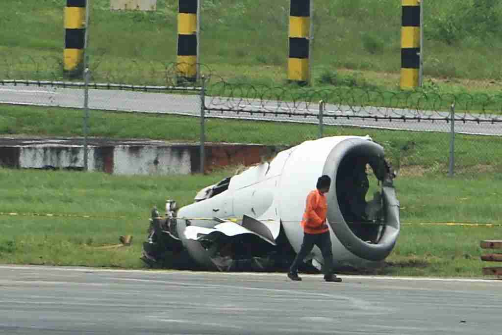 A torn-off engine pod from a XiamenAir Boeing 737-800 series passenger aircraft, operating as flight MF8667 from Xiamen to Manila, is seen after the aircraft slid off the runway while attempting to land in bad weather at the Manila international airport on August 17, 2018. - A Chinese passenger jet slid off the runway as it landed at Manila airport in torrential rain, authorities said August 17, with all 165 people on board safely evacuated though a few suffered minor injuries. (Photo by TED ALJIBE / AFP) (Photo credit should read TED ALJIBE/AFP/Getty Images)