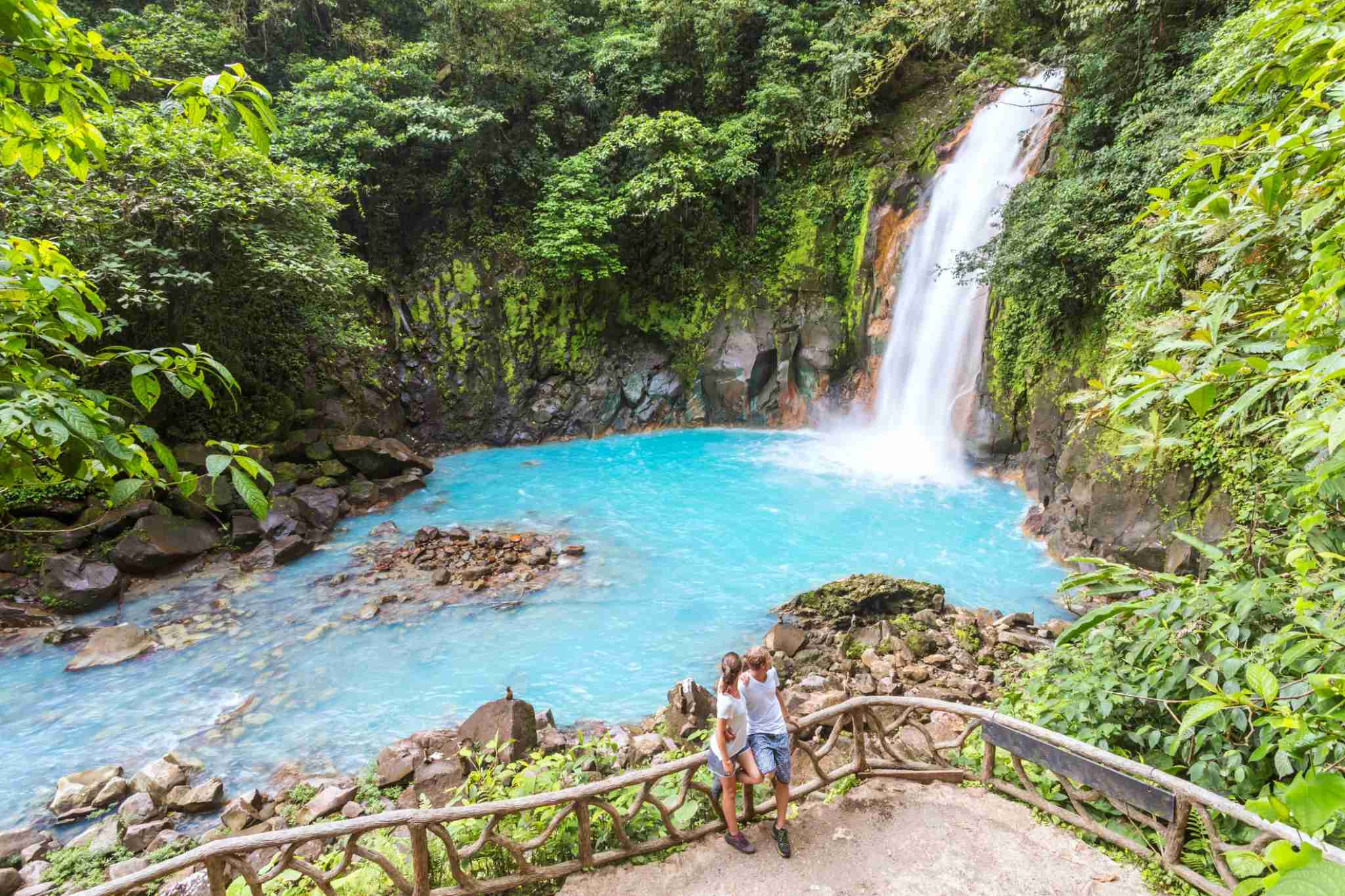 Tourist couple looking at Rio Celeste waterfall, Tenorio Volcano National Park, Guanacaste, Costa Rica Getty Images
