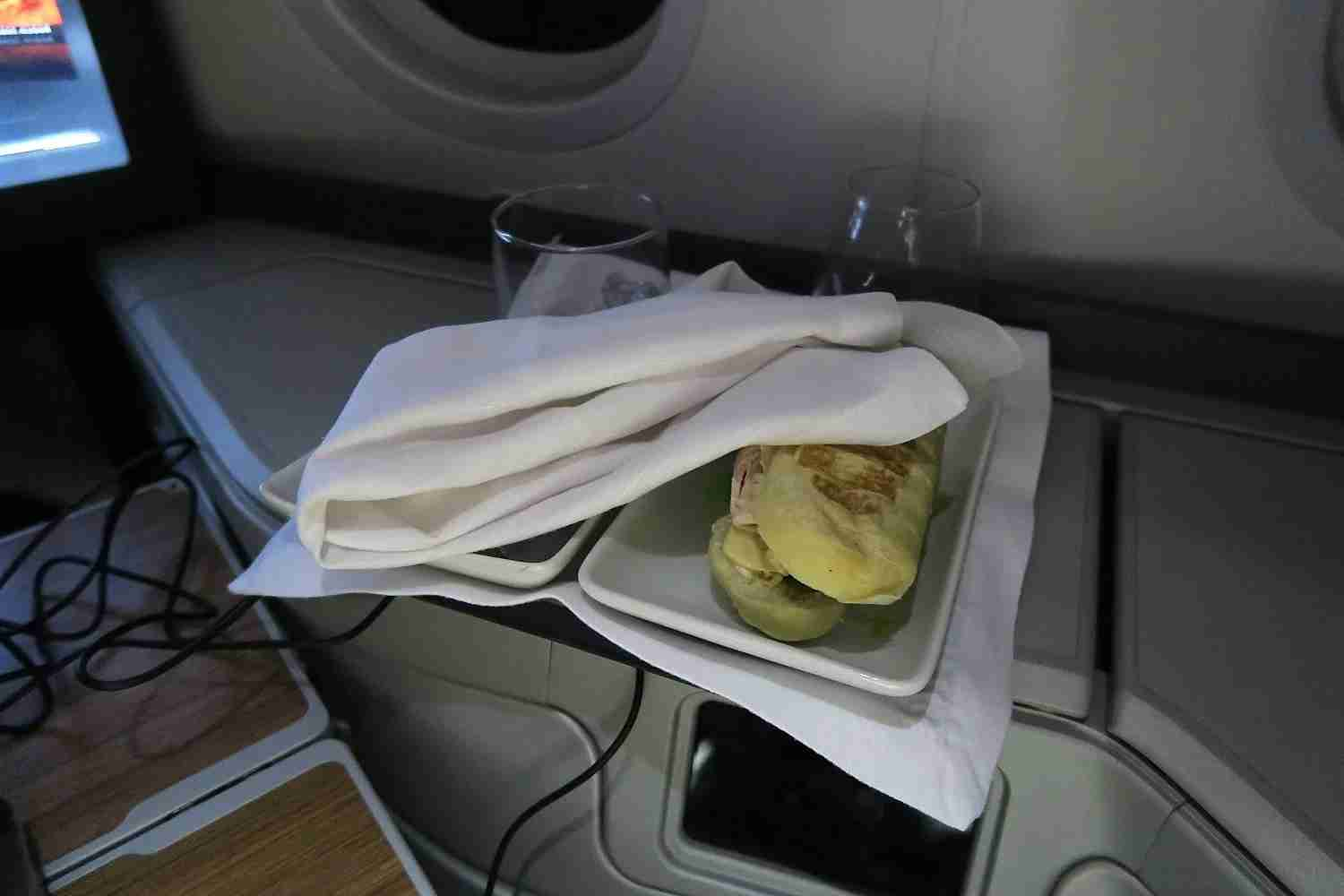 This tray sat beside my seat for hours before I took it to the galley myself.